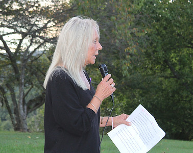 JOHN E. USALIS/STAFF PHOTOGaudenzia Foutain Springs Program Director Jane Roberts speaks to the clients and staff at the helipad before the launching on Monday of the lighted lanterns in recognition of National Recovery Month.