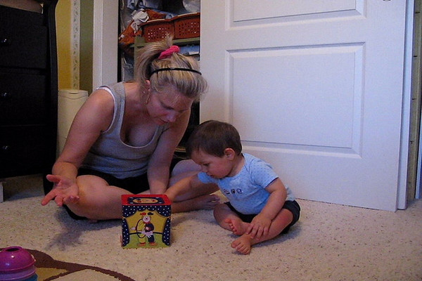 Donovan loves his Jack-in-the-Box.<br /> Age 10 mos.