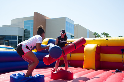 Bianca Garcia(left) and Michelle Gurrusqueta duel it out on the East Lawn during Island Bash.