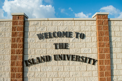 WELCOME TO THE ISLAND UNIVERSITY, on display at the entrance of the campus.
