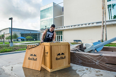 Kennith Cantu helps himself to a Red Bull drink from a crate dropped off by Red Bull.