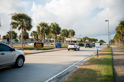 Vehicles make their way to Island Dr. on the first day of class.