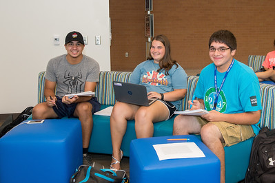 Freshmen Luis Sanchez(left) Jaime Matise and Marcus Martinez catch up on some after class studies in the Tejas Lounging area located in the University Center.