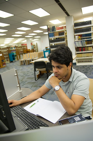 Engineering student Abdulrahman Washili reviews ebooks material for Statics.