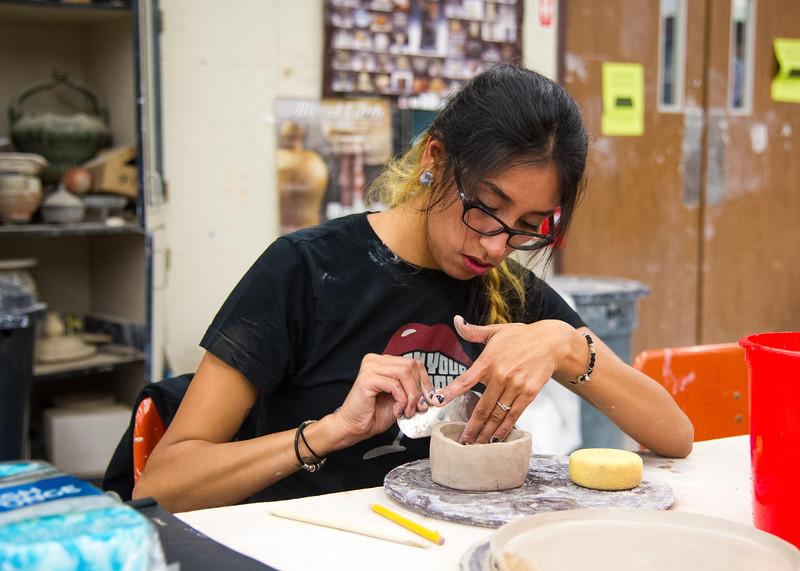 Student Stephanie Montoya molds her creation in Ceramics 1.