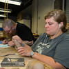 Bachelor of Fine Arts student, Gracie Peck, creates a relief mold for her Intermediate Sculpture class.