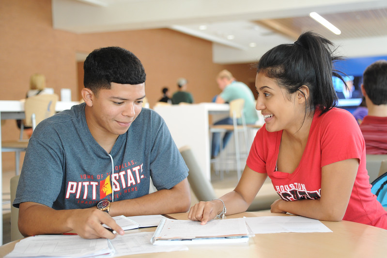 Students Cesa Soto(left) and Ruby Bustoz  work side by side in the Tejas lounge room, making their academic schedules.