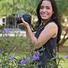 Student Lina Roel has her portrait taken as she is working on her Photography I assignment on campus.