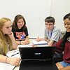 Freshman students Brittany Roberts(left), Erica F. , Mitchell Pesietto and Carolina Velasquez collaborate on a question in First year Seminar class.