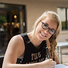 Student Kallye Harris pauses for a photo as she works on her homework just ouside the Starbucks on campus.