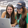 Student Priscilla Cantu and Sarah Bomego work side-by-side on their Philosophy assignment.