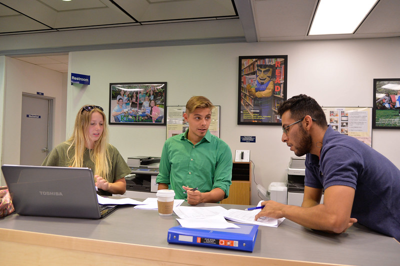 Students Stephanie Menut, Richard Schreiber and Zachary Nava prepare for their international business meeting.