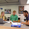 Students Stephanie Menut, Richard Schreiber and Zachary Nava prepare for their international business meeting.