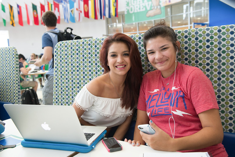 Students Alanna Garza(left) and Paige Hernandez(right) work together on their class assignment in the University Center.