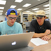 Students Harriss Hipp(left) and Stephan Barrera(right) work together on their Calculus II Math lab assignment.