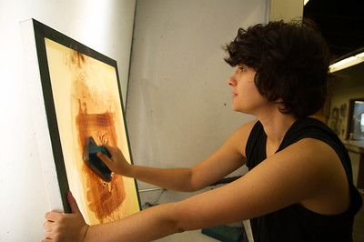 Student Isabella Trevino prepares the silkscreen for her next print.