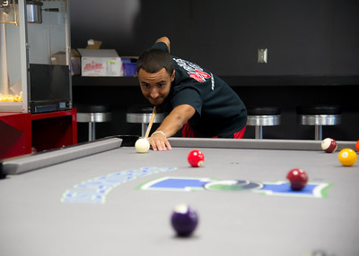 Student Dylan Marquez faces off against a friend in a game of pool in the Breakers Game Lounge in the University Center.