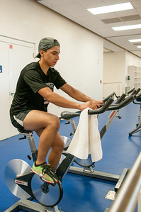 Christopher Suarez takes some time to work out before his composition class in the Dugan Wellness Center.
