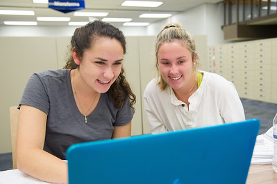 Student Rachael Har and Joelle Boudouris work together on their problem in Microbiology.