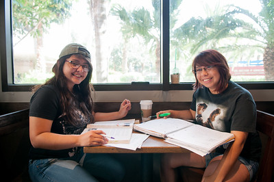 Stephanie Lozano(left) and Caryn Garcia take a break from their studies for a portrait in the Starbucks cafe.