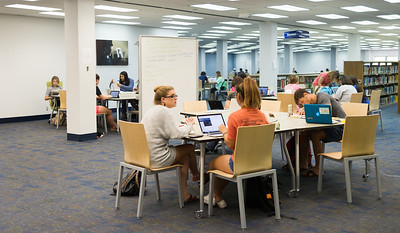 Studious students embrace the new Mary and Jeff Bell Library furnishings as it gives them more space for their materials as well as provides more comfortable, modernly designed seating.