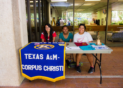 Students Caitlin Silva, Jasmine Thompson, and Amitie Maldonado work to recruit members for Circle K International, a student volunteer organization.