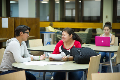 Students Amber Layton and Ana Cerda work together on analyzing an English composition essay.