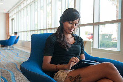 Genesis Castillo-Torres takes a break after classes in the Tejas lounge room in the University Center.