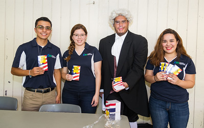 Benjamin Franklin (Victor Hinojosa) and GSA students Richard Torres(left) Avery Pantoja and Carolina Ouvares hand out Constitution booklets near the library to students for Constitution week.