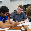 Marcos Rodriguez(left), Lane Cosper and Pearce Bennett work together on Algebra problem in Casa.