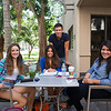 Laura Mansivais(left), Valeria De Luna, Larissa Quinonez and Farid Ganem pause for a quick picture during their free time outside Starbucks.