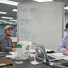 Thomas Solomon(left) and Aaron Connolly using the library's resources to finish their business calculus assignment.