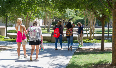 Students exit the O'Connor business bulding en route to their proceeding classes.