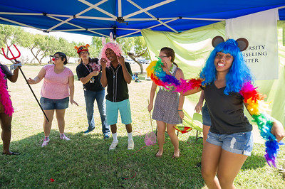 Students have fun between classes putting on outfits and dancing together at the University Counseling Center event hosted outside of Bay Hall