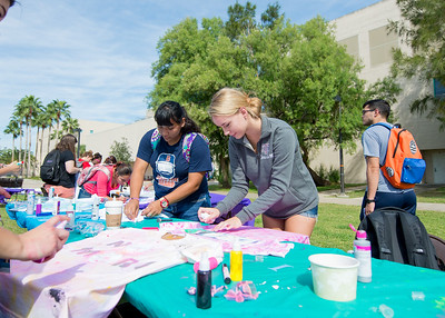 Erin Pharr (center) decorates a t-shirt for the NO MORE campaign that raises awareness against domestic violence.