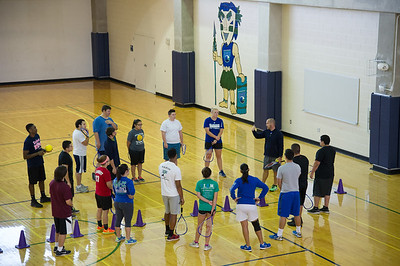 Instructor Geoff Grawn(right) instructs students on proper workout attire in the Individual and Dual Lifetime Sport class.