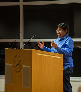 """Gloria Vasquez (student) reads her piece, """"Five Out of Five Hearts,"""" from the Switchgrass Review at the Islanders Creative Writing Fall Festival."""