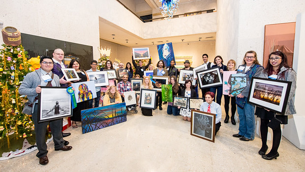 Students that took part in the PC Art Show pose for a picture with their submitted art work.