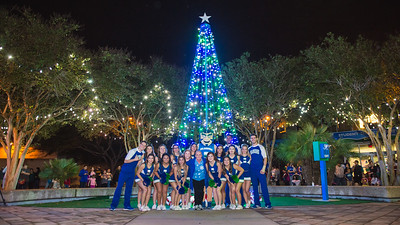TAMU-CC's cheer and dance team poses with first lady Kathy Killebrew during the Islander Lights Celebration.
