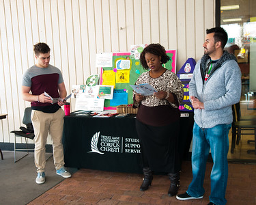 Connor Carnes(left) Jermeka Johnson and Emmanuel Guadarrama stand readily available to pass out information on the university's SSS programs.