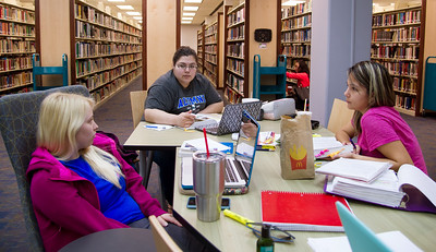 Madyson Halford, Marissa Ramirez, and Leslie Rosales are working together to solve their assignments on Nursing.