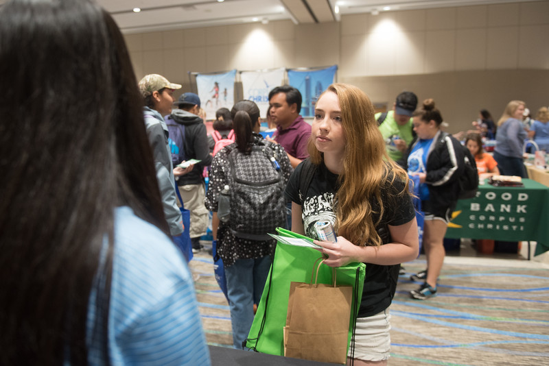 Student Sarah Lambert receives information from the Corpus Christi RTA during the community fair event in the UC.