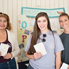 Yasmin Perez (left), Kimberly Carrejo and Bailey Moehl set up in the breezeway to promote the Omega Phi Alpha sorority