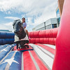 Lauren Garcia rides a mechanical bull during the ROTC recruitment event.