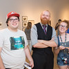 Jared Brandt (left), James Allan and Ashley McGee pose for a picture during the Abstract and Strange TAMU-CC undergrad exhibition at the Islander Gallery.