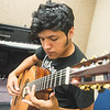 Jesse De Los Santos plays the guitar in the center for arts building.