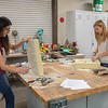 Students Erika Velazquez and Payton Torres work on molds for their sculptures.