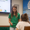 Island ambassador Ashlynne Gooch speaks to a student in the islander welcome center.