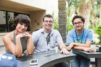 Chloe Perez(left), Joshua Messina, Gaberiel Hinojosa sit outside of the Mary and Jeff Bell Library.