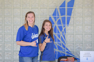 Island Ambassadors Ana Norris (left) and Ashlynne Gooch welcome Islanders at the Welcome Center.